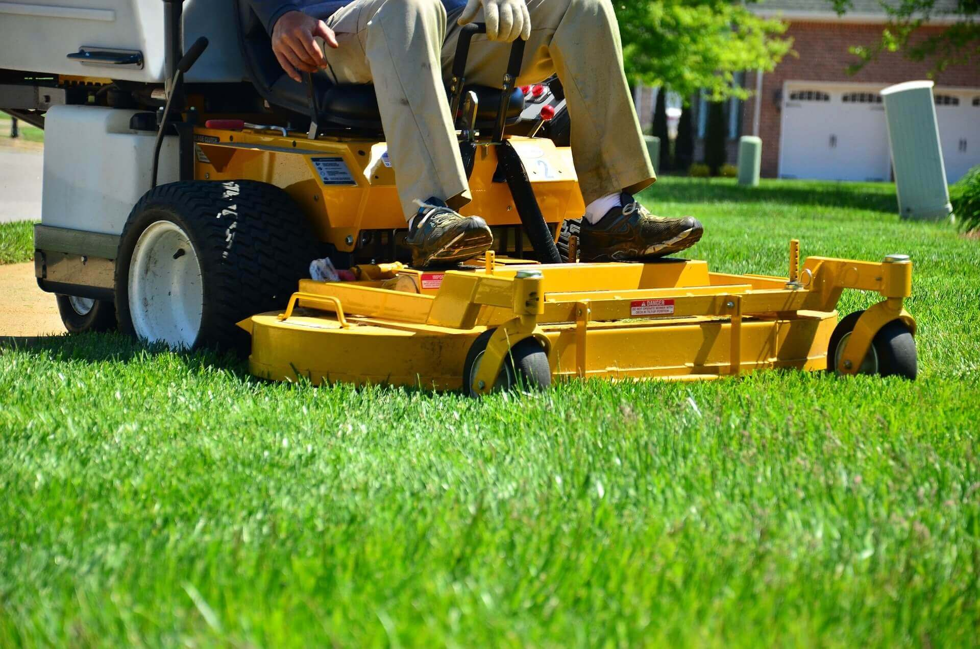Riding lawn mower on grass