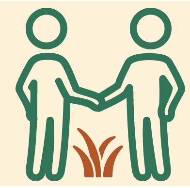 silhouette of two people shaking hands over grass